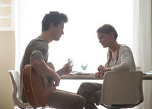Romantic boy playing guitar for her girlfriend Royalty Free Stock Photo