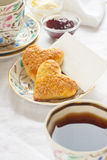 Romantic breakfast. With tea, jam, butter and scones Royalty Free Stock Photography