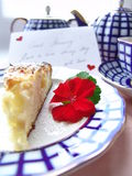Romantic breakfast. With love served breakfast. Cup of tea with a piece of cake decorated with postcard: Good morning! Have a nice day! With love Royalty Free Stock Image