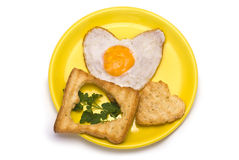 Romantic Breakfast. Heart-shaped Fried egg and Toasts on Plate isolated on white Royalty Free Stock Photos