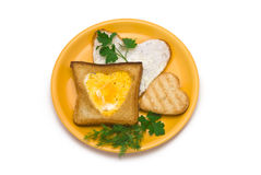 Romantic Breakfast. Heart-shaped Fried egg and Toasts on Plate isolated on white Royalty Free Stock Image