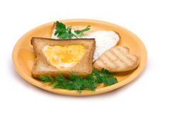 Romantic Breakfast. Heart-shaped Fried egg and Toasts on Plate isolated on white Royalty Free Stock Photography
