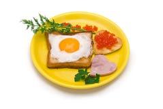 Romantic Breakfast. Fried egg, heart-shaped toast, caviar Stock Images