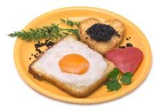 Romantic Breakfast. Fried egg, heart-shaped toast, caviar Stock Image