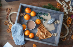 Romantic breakfast in a bed with cocoa tangerines and wafers Royalty Free Stock Photo