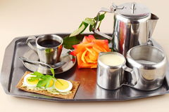 Romantic breakfast in bed. Coffee set, rose, crisp with egg on a silver tray. Healthy concept. Love. Romance. Romantic breakfast in bed. Coffee set, rose, crisp Royalty Free Stock Photography