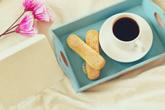 Romantic breakfast in the bed: cookies, coffee and blank note Stock Photo