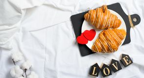 Romantic Breakfast in Bed, Croissants, Love Letters on White Bed Sheet royalty free stock photography