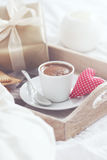 Romantic breakfast with coffee, cookies, gift box and red plush heart, valentines day concept Royalty Free Stock Image