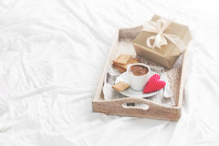 Romantic breakfast with coffee, cookies, gift box and red plush heart, valentines day concept Royalty Free Stock Photo