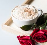 Breakfast coffee love heart red rose setting with white mug and gift box in Valentine`s day setting. Romantic breakfast coffee for Valentines day surprise for Royalty Free Stock Photo