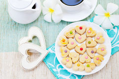 Romantic breakfast concept Cup of coffee with sugar icing decorated heart shaped cookies royalty free stock photography