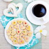 Romantic breakfast concept Cup of coffee with sugar icing decorated heart shaped cookies royalty free stock image