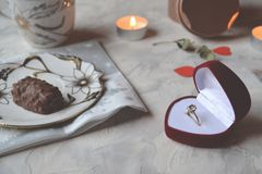 Romantic breakfast for a couple in love. Engagement ring in the box. The ring as a symbol of love Royalty Free Stock Images