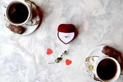 Romantic breakfast for a couple in love. Engagement ring in the box. The ring as a symbol of love Royalty Free Stock Photos