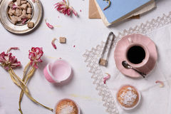 Romantic breakfast, fresh coffee, cupcake desserts and pink flowers served with love. Top view. Stock Images