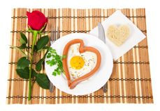 Romantic breakfast with fried eggs in shape of Stock Photography
