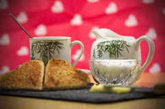 A romantic breakfast, milk and a cup of coffee Stock Photos
