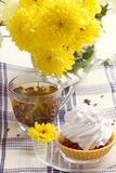 Romantic breakfast. Tea, cake, chrysanthemum Stock Images