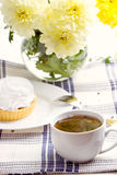 Romantic breakfast. Tea, cake, chrysanthemum Stock Image