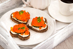 Romantic breakfast-toasts  with red caviar and coffee Royalty Free Stock Photography