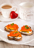 Romantic breakfast-toasts  with red caviar and coffee Stock Photo