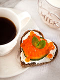 Romantic breakfast-toasts  with red caviar and coffee Stock Image