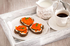 Romantic breakfast-toasts  with red caviar and coffee Royalty Free Stock Photos