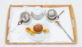 Romantic breakfast tray with fragrant tea fresh baking and jam. On white background Stock Images