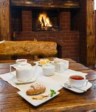 Romantic breakfast for two near fireplace Royalty Free Stock Photography