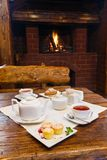 Romantic breakfast for two near fireplace Stock Photo