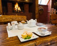 Romantic breakfast for two near fireplace Royalty Free Stock Image