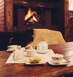 Romantic breakfast for two near fireplace Stock Photography