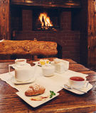 Romantic breakfast for two near fireplace Royalty Free Stock Photos