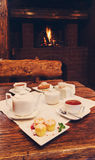 Romantic breakfast for two near fireplace Royalty Free Stock Photo