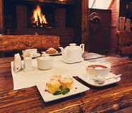 Romantic breakfast for two near fireplace Stock Images
