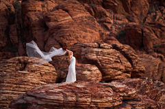 Romantic bride 7. Bride in the canyon of fire Royalty Free Stock Photography