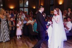 Romantic bride and groom dancing and holding hands at wedding re Royalty Free Stock Image