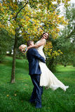 Romantic bride and groom embrace. At wedding walk Stock Images