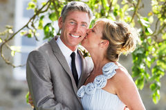 Romantic Bride And Groom Embracing Outdoors royalty free stock image