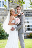 Romantic Bride And Groom Embracing Outdoors royalty free stock images