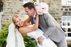 Romantic Bride And Groom Embracing Outdoors Stock Photo