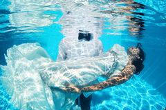 Romantic bride and groom underwater Stock Image