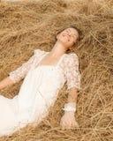 Romantic bride on haystack. Stock Photo