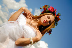 Romantic bride wearing flower wreath and chiffon Royalty Free Stock Photos