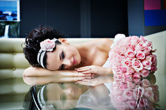 Romantic bride with a wedding bouquet. On luxury modern interior Royalty Free Stock Images