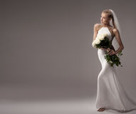 Romantic bride in wedding dress. Stock Images