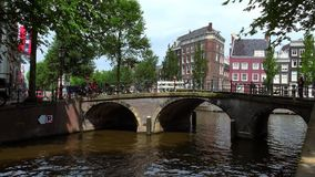 Romantic bridge in the canal area of Amsterdam City of Amsterdam. Romantic bridge in the canal area of Amsterdam Amsterdam Netherlands videoclip stock video footage