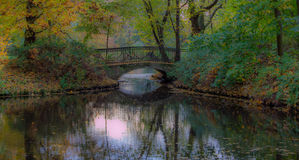 Romantic bridge in the park. Autumn colorful trees. Fall leaves Royalty Free Stock Photography