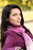 Romantic brunette in autumn park Royalty Free Stock Photos